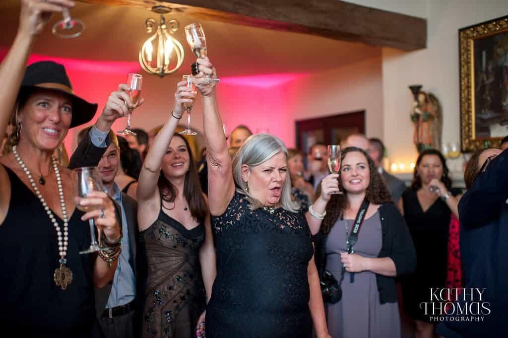 Casa Feliz same sex wedding reception toast with magenta uplighting