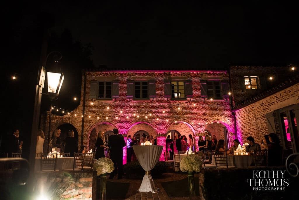 Casa feliz same sex wedding outdoor portion of venue with magenta uplighting