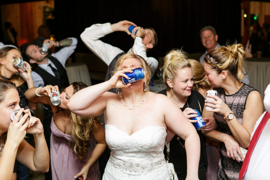 Delamater House wedding bride groom and guests shotgunning beer during reception
