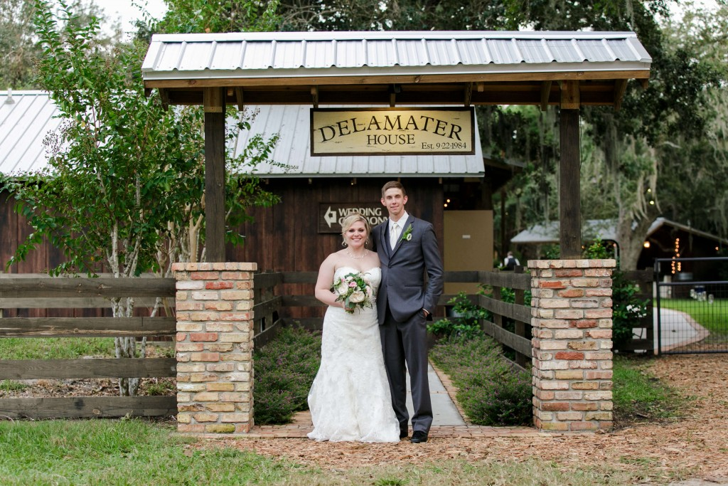 Delamater House wedding bride and groom at entrance in wedding dress and tux