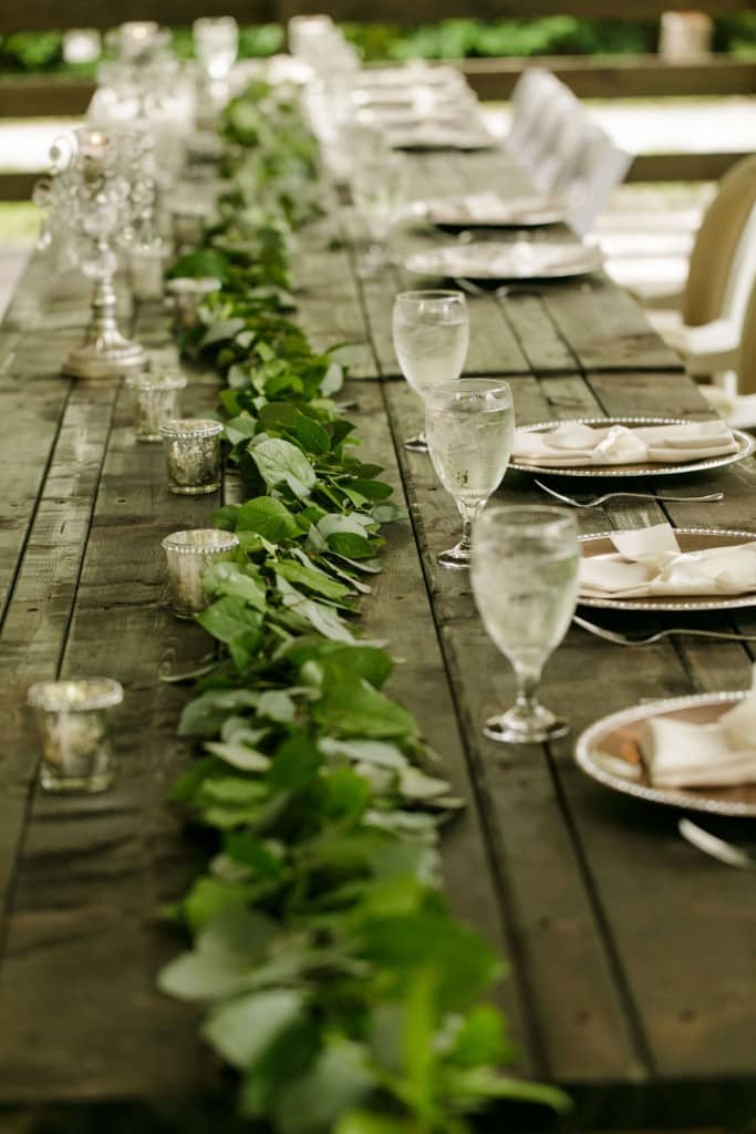 Delamater House wedding table decorations with vines and wooden table