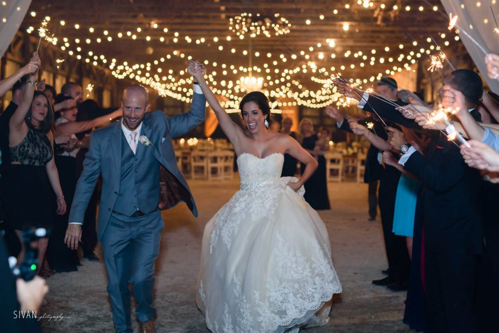 3M Ranch wedding couple grand sparkler exit from reception area