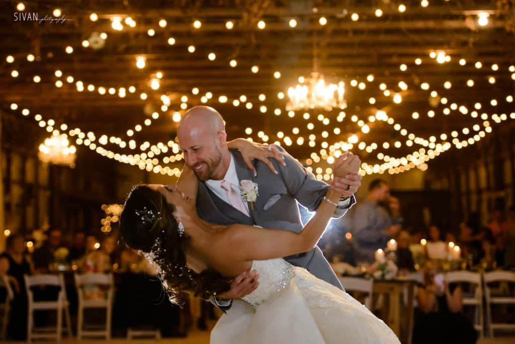 3M Ranch wedding couple first dance in barn reception area with market lighting