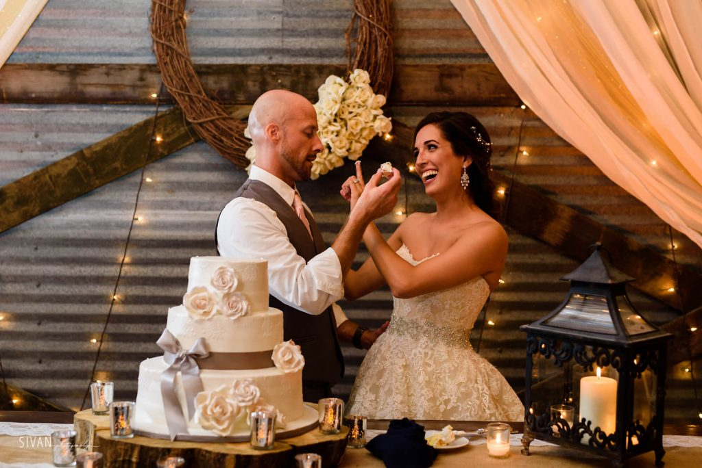 3M Ranch wedding couple cutting cake in reception area