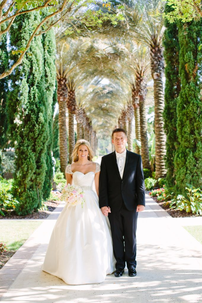 Bride and groom at Four Seasons under tree arch