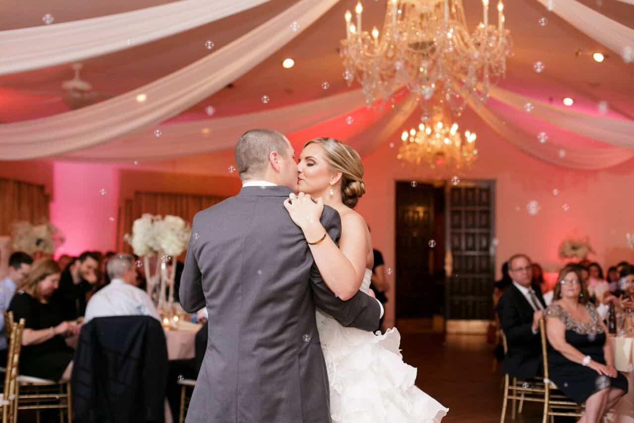 Orlando wedding - Highland Manor bride and groom first dance with bubbles and blush pink uplighting