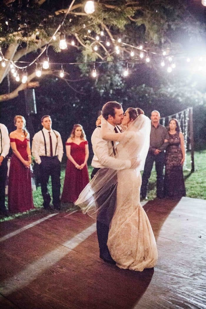orlando female DJ at private residence wedding  bride and groom first dance on wooden dance floor