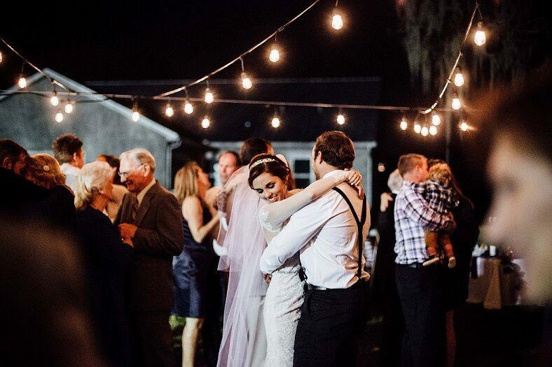 orlando female DJ at private residence wedding reception dance floor with market lighting