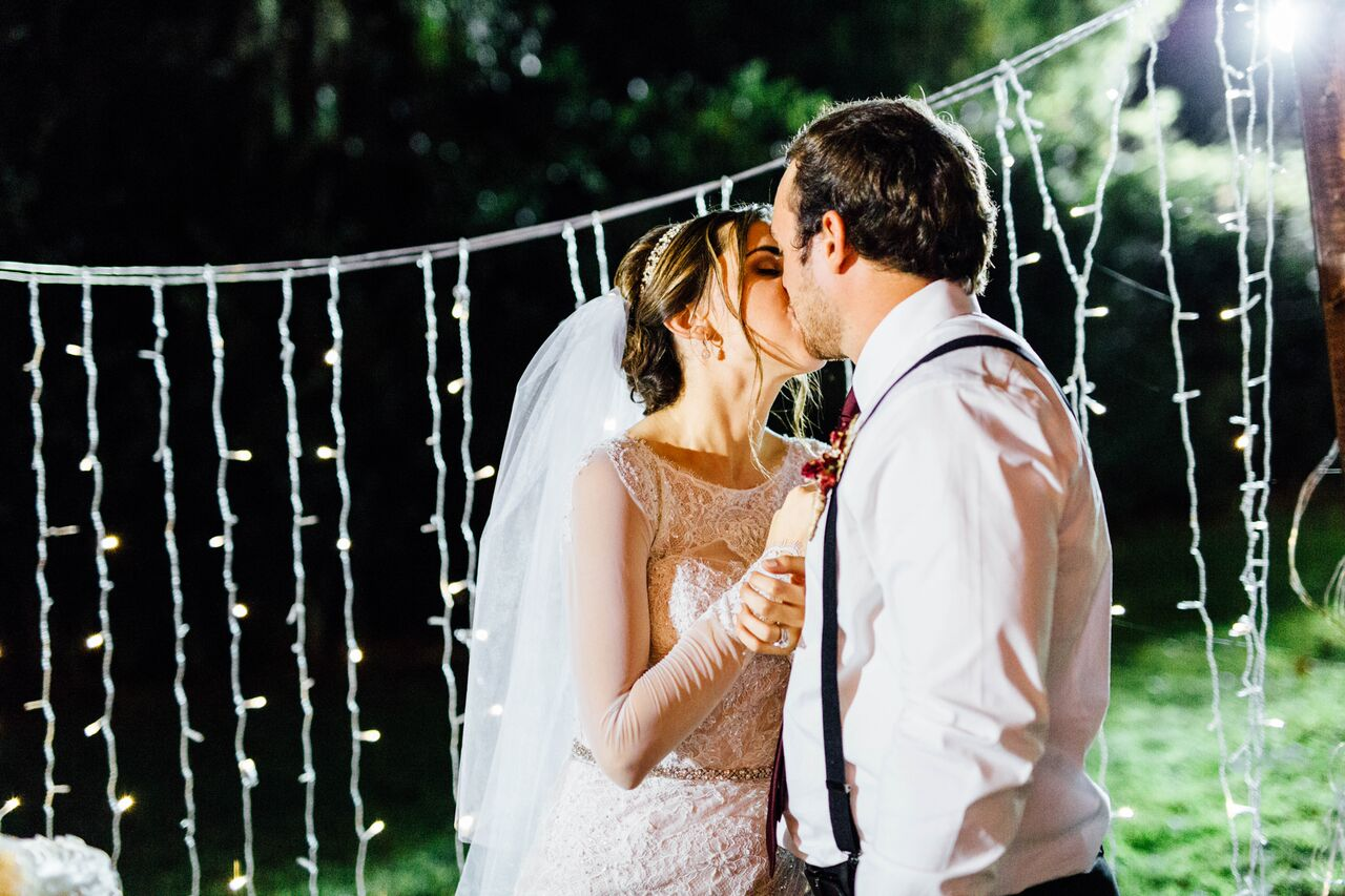 orlando female DJ at private residence wedding bride and groom kissing