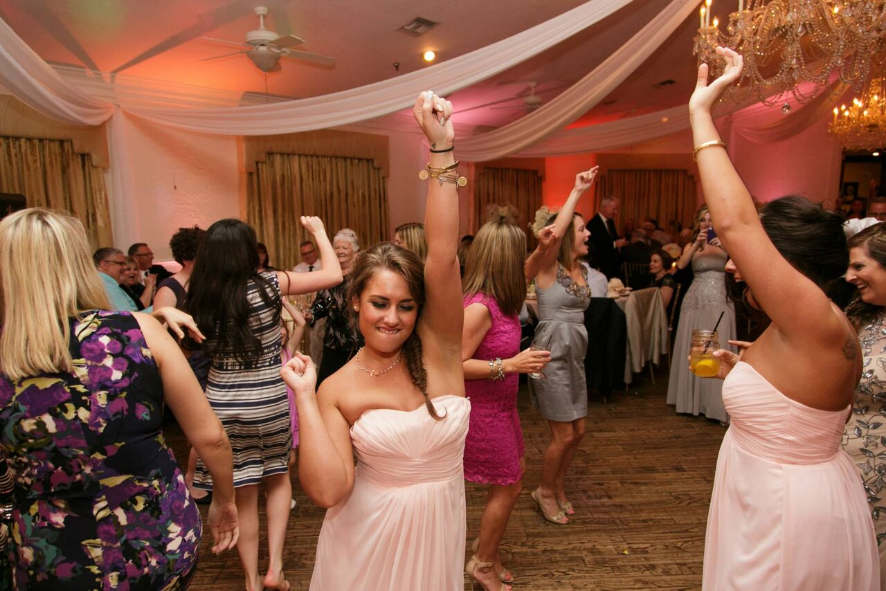 Orlando wedding - Highland Manor reception dancing with blush pink uplighting