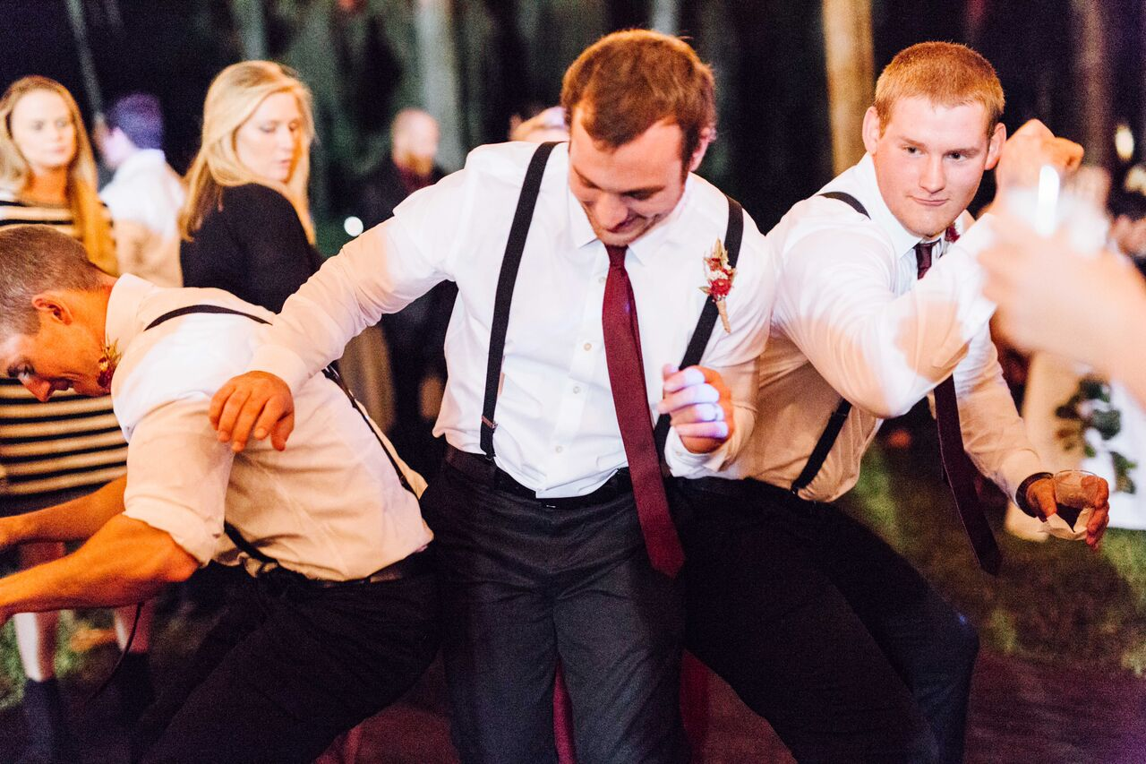 orlando female DJ at private residence wedding  groom and groomsman dancing