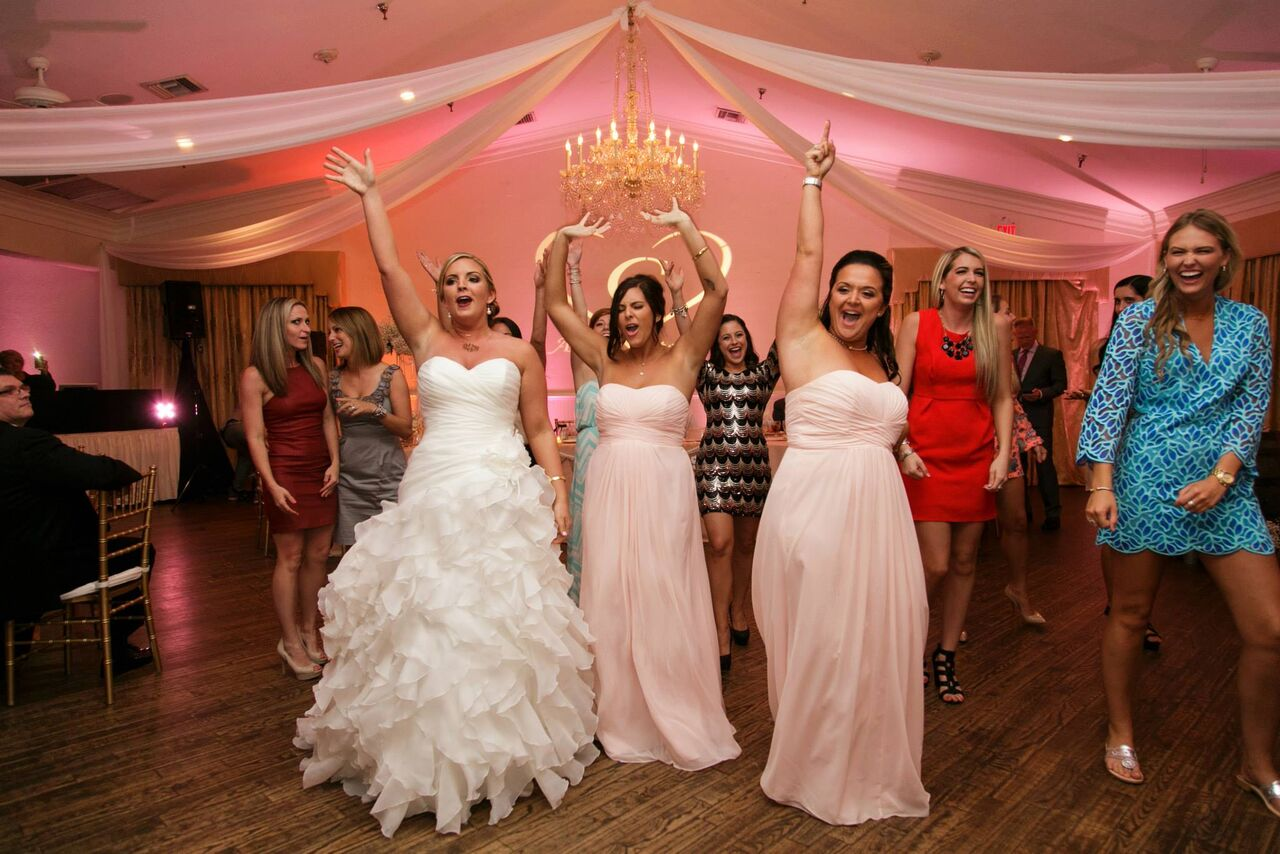 Orlando wedding - Highland Manor reception dancing with blush pink uplights