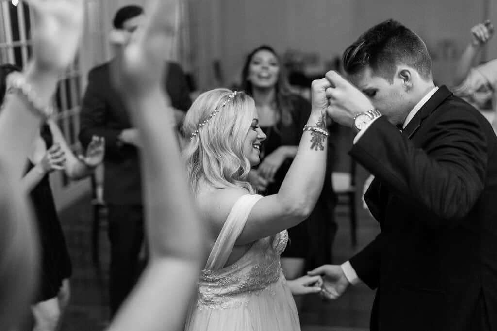 experienced orlando wedding dj at Luxmore Grande Estate wedding reception dancing with bride and groom