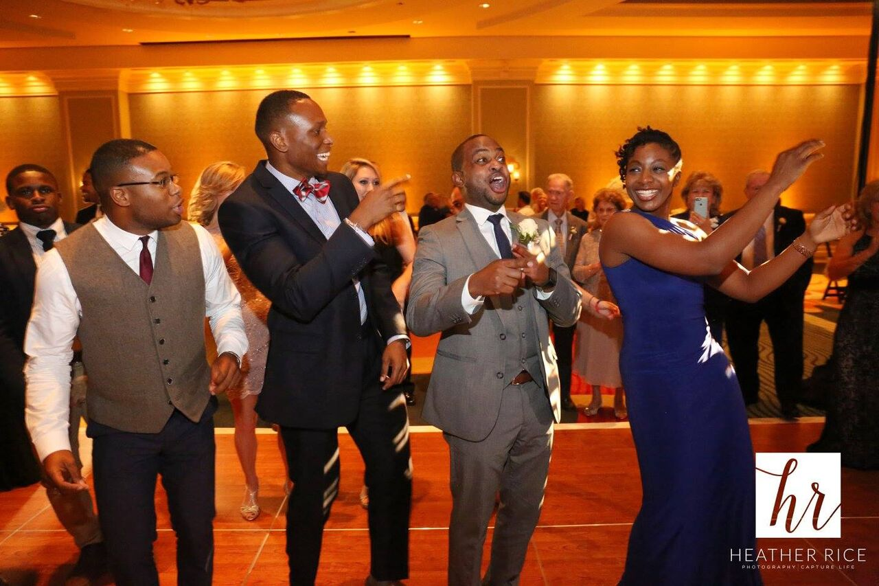 Orlando Wedding - Omni Champions Gate reception dancing with yellow uplighting