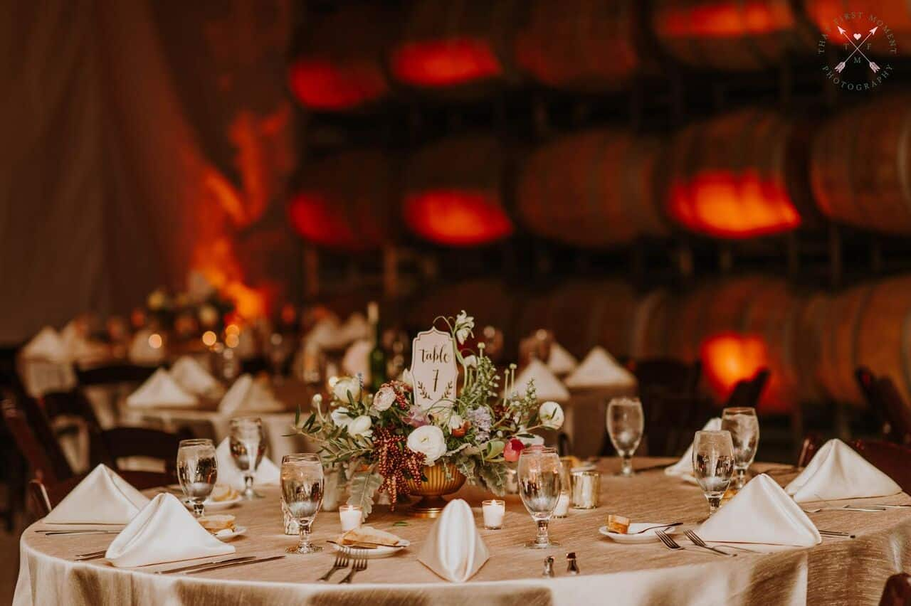 Orlando wedding at Quantum Leap Winery reception tables with amber uplighting
