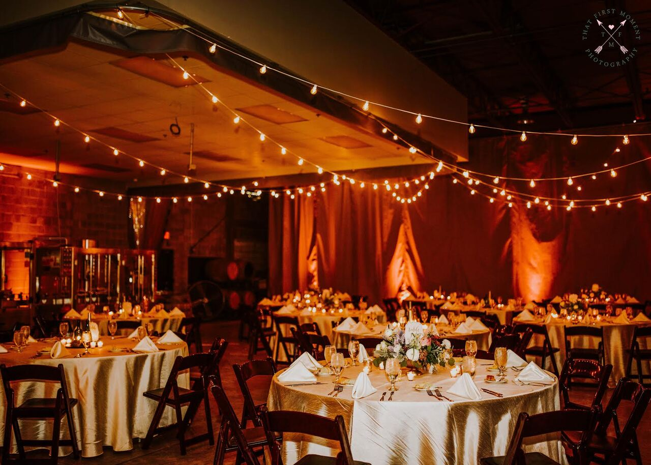 Orlando wedding at Quantum Leap Winery reception with amber uplighting and market lights