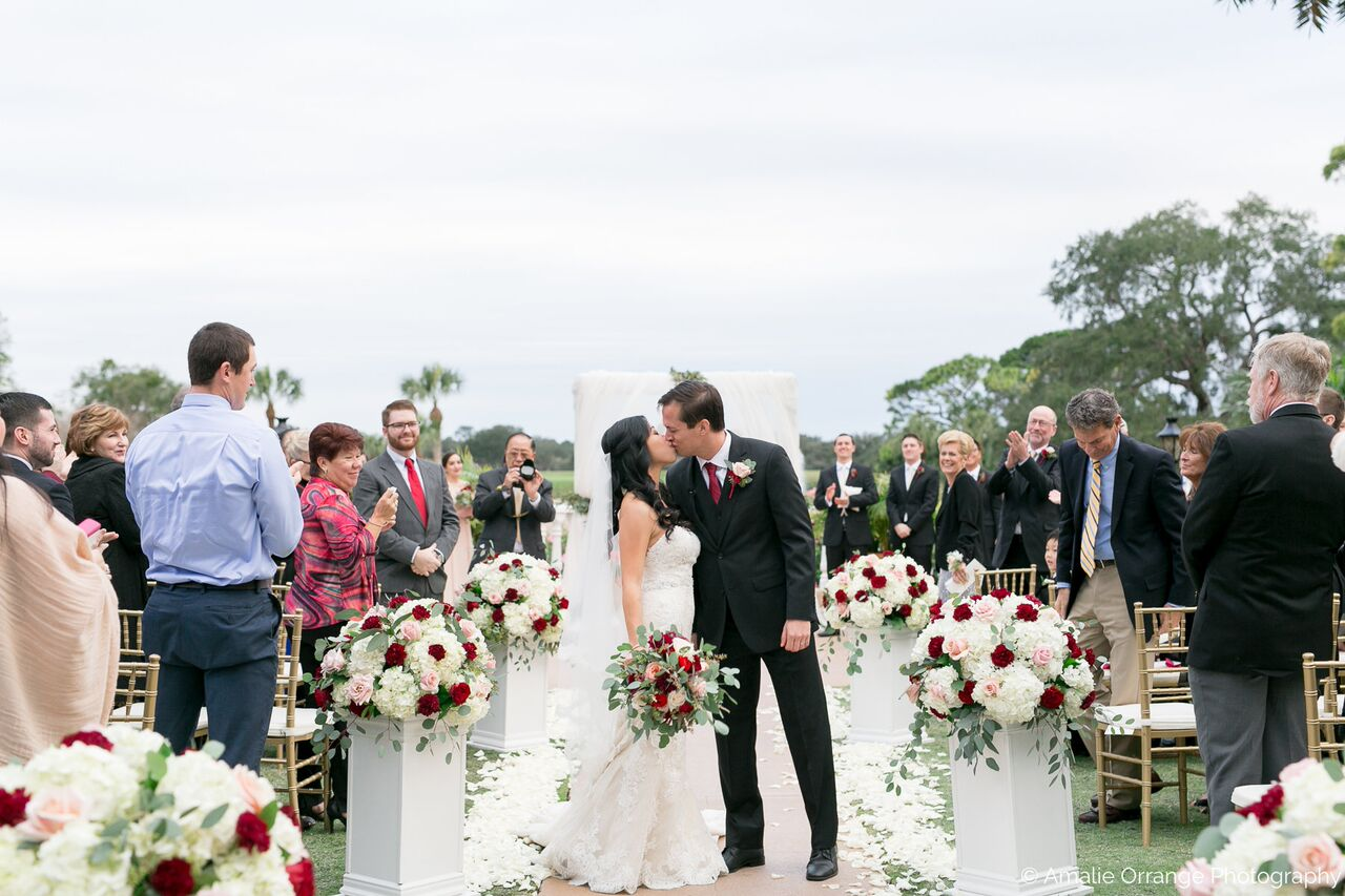 Orlando wedding at Mission Inn Resort ceremony setup and couple kissing
