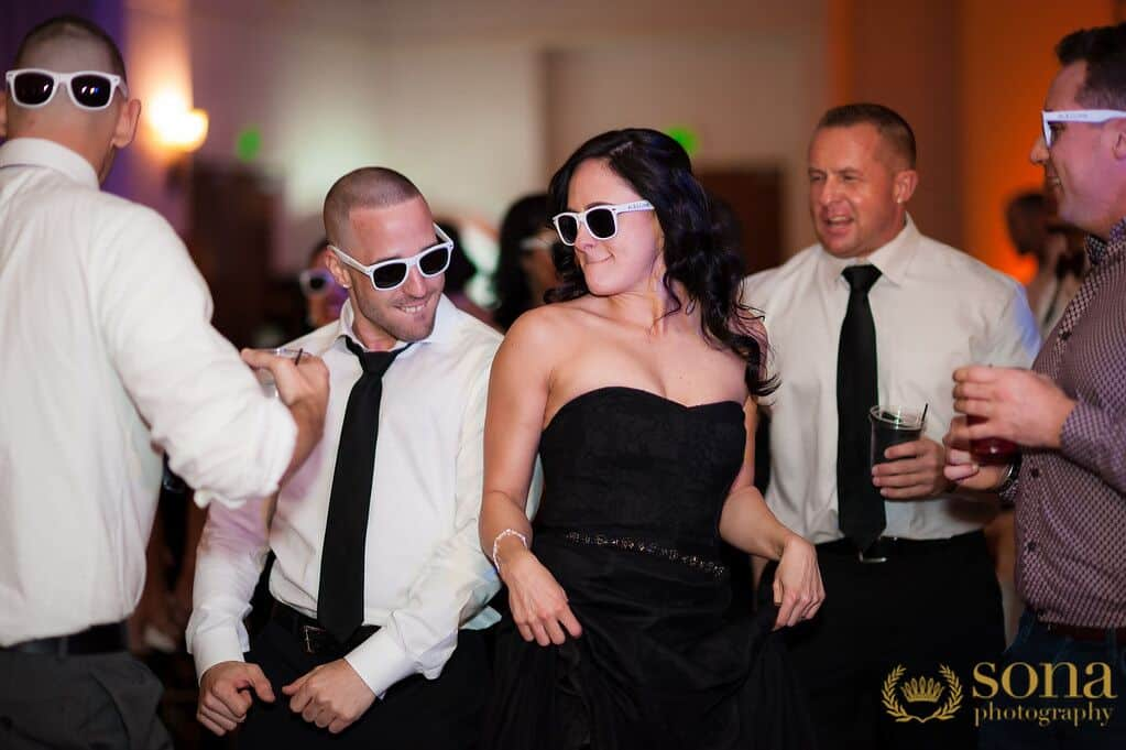 Orlando united wedding at Lake Mary Event's Center reception dancing with sunglasses on