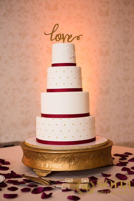 Orlando united wedding at Lake Mary Event's center wedding cake with cake topper