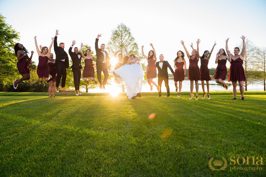 Orlando united wedding at Lake Mary Event's Center couple and bridal party jumping