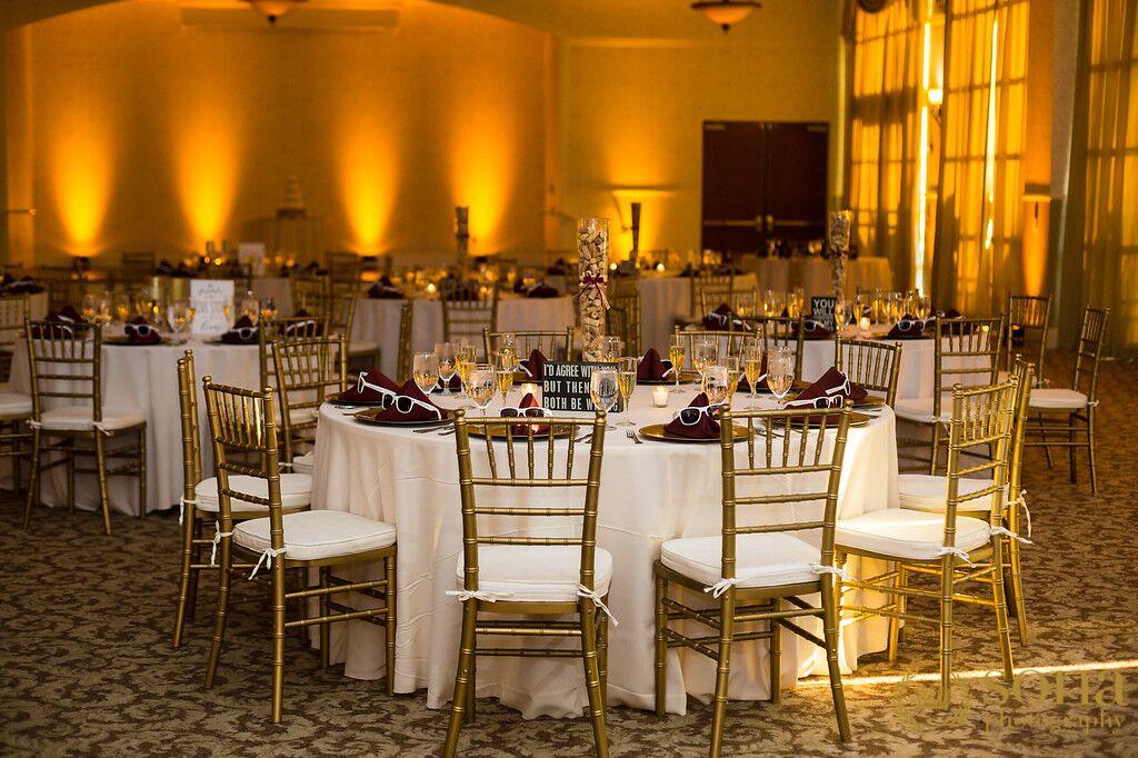 Orlando united wedding at Lake Mary Event's Center reception area with amber uplighting