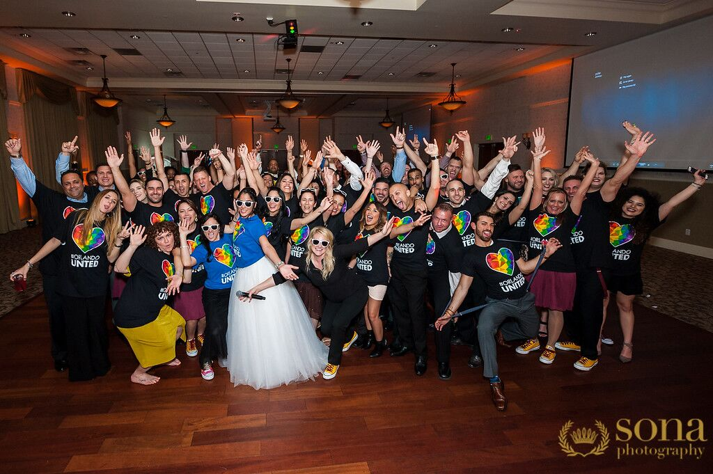 Orlando united wedding at Lake Mary Events Center group photo with orlando united t-shirts