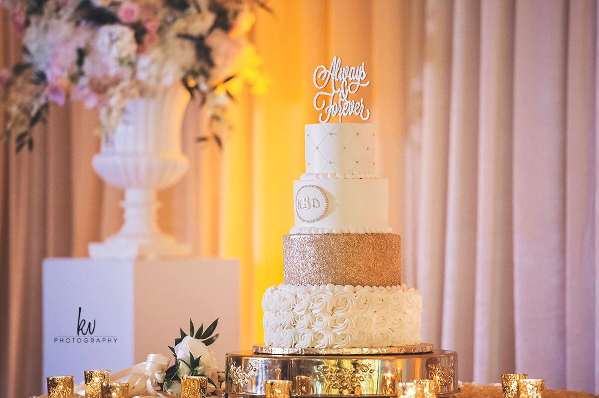 Orlando wedding at Lake Mary Event's Center wedding cake with cake topper and amber uplighting