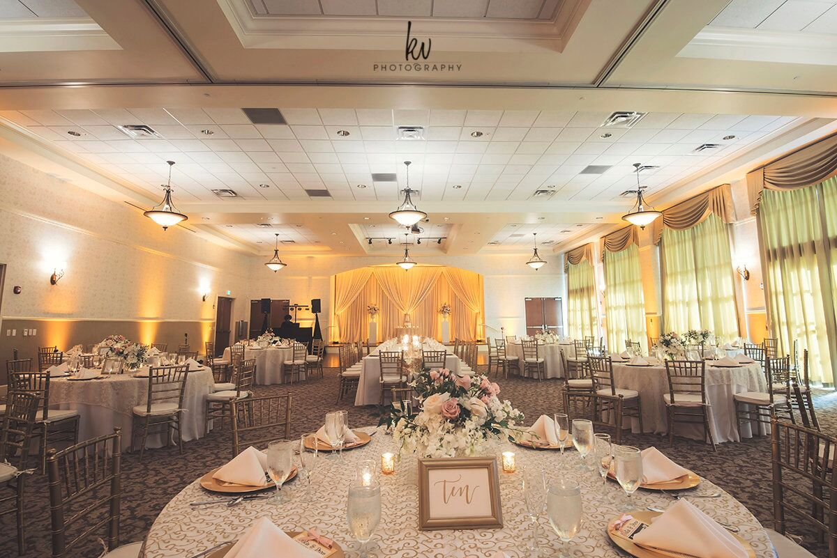 Orlando wedding at Lake Mary Event's Center reception area with amber uplighting