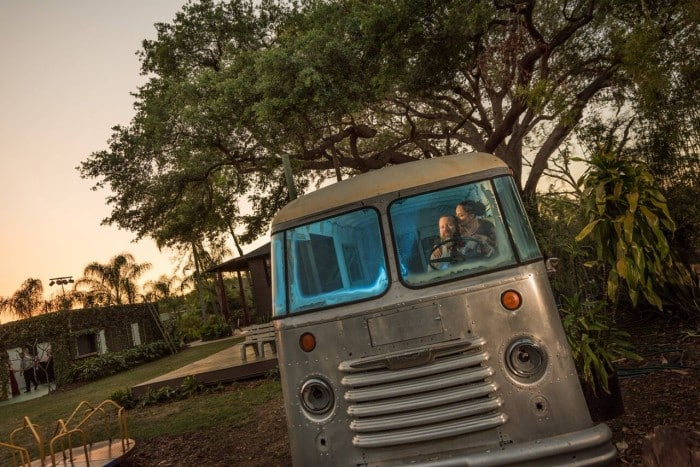 Wedding DJ Entertainment at The Acre Orlando hippie van with bride and groom in it
