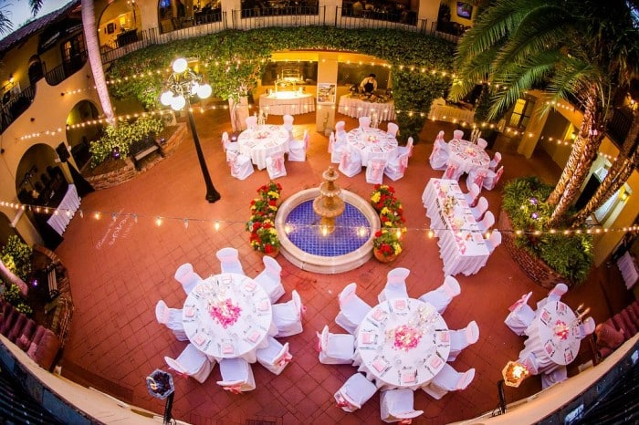 Orlando Wedding DJ Services at Mission Inn Resort wedding reception area with blush pink uplights and market lighting