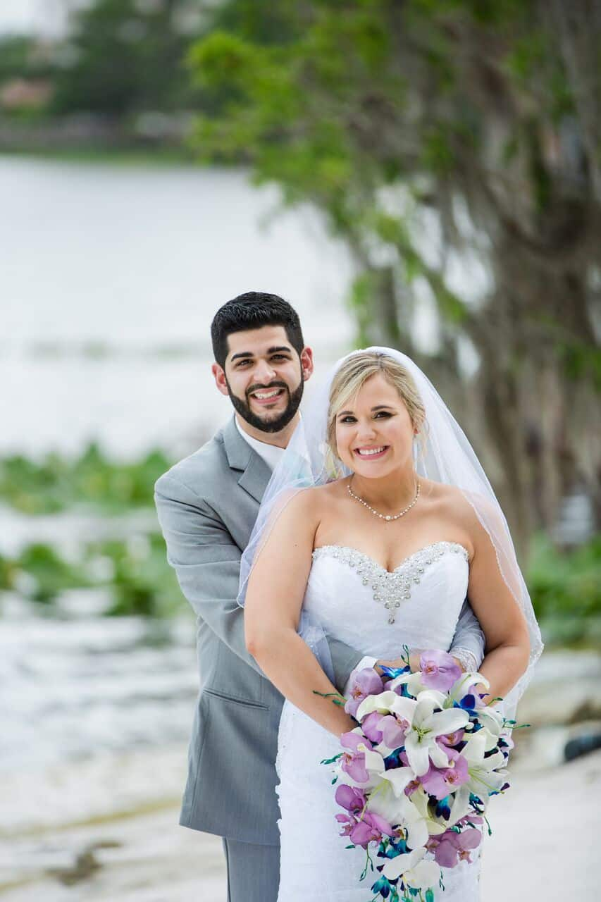 Our DJ Rocks at Paradise Cove beach themed wedding with teal uplighting bride and groom photos