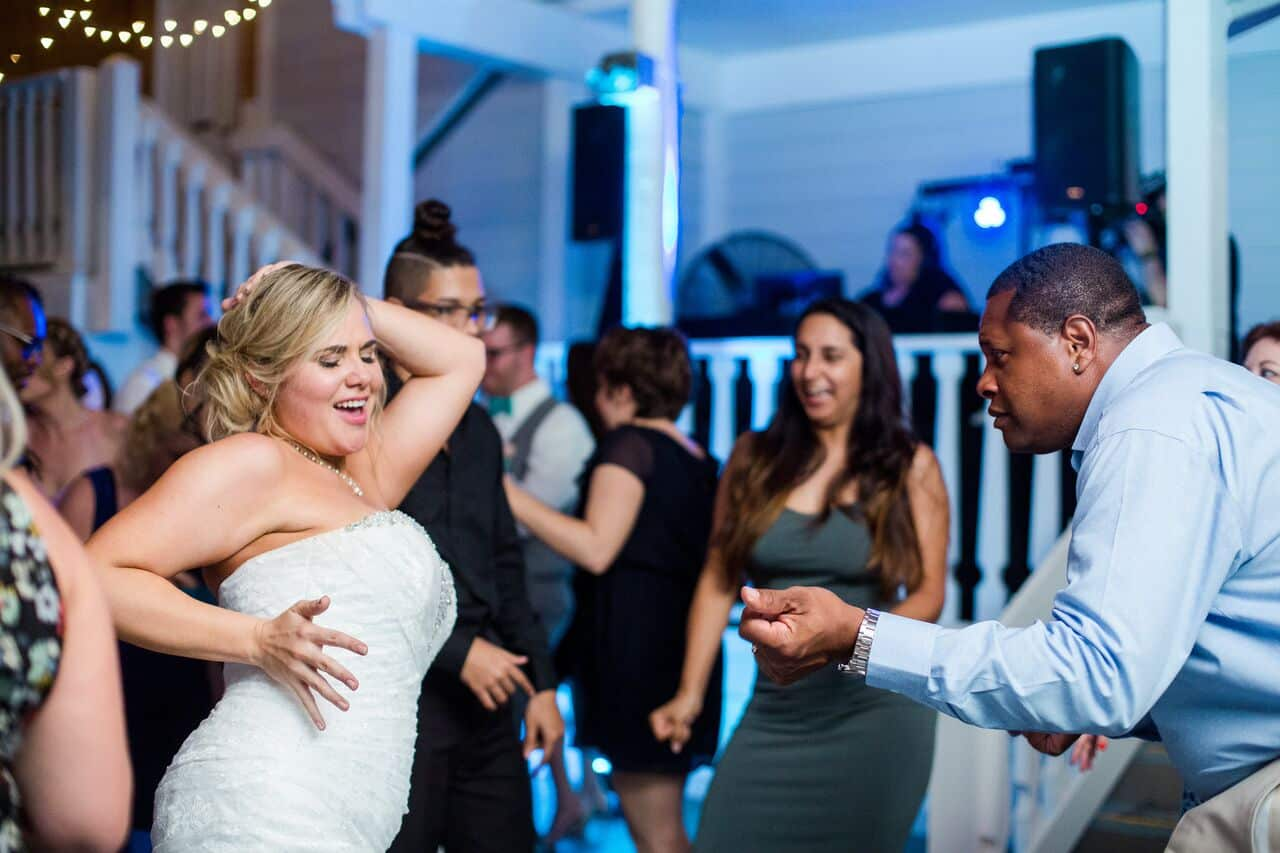 Our DJ Rocks at Paradise Cove beach themed wedding with teal uplighting reception dancing