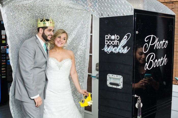 Our DJ Rocks at Paradise Cove beach themed wedding with teal uplighting photo booth provided by Photo Booth Rocks