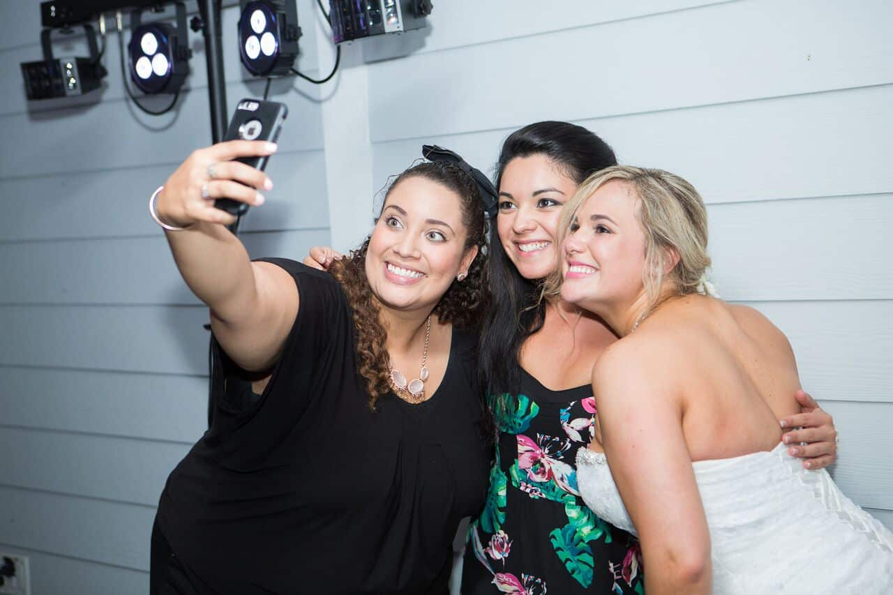 Our DJ Rocks DJ Tabitha at Paradise Cove beach themed wedding with teal uplighting