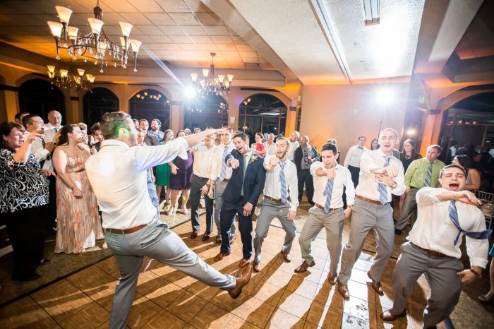 wedding dj fun at mystic dunes resort wedding reception dancing with amber uplighting
