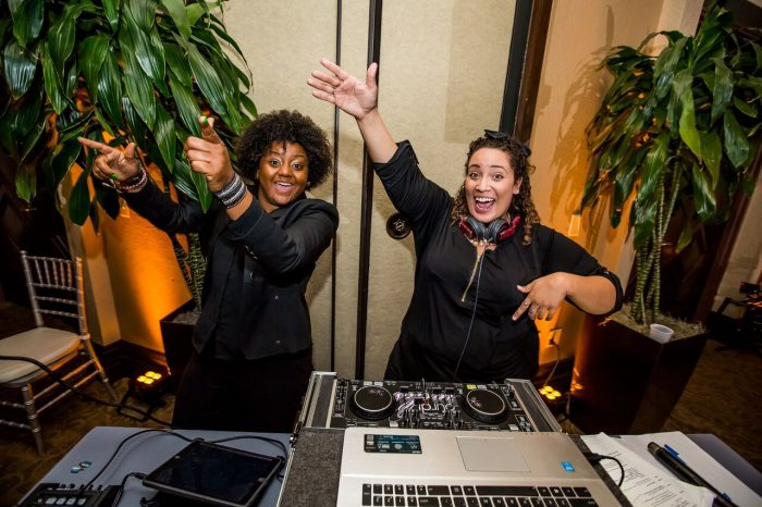 wedding dj fun at mystic dunes resort wedding Our DJ Rocks Tabitha and Cierra with amber uplighting