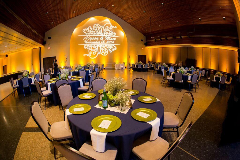 orlando wedding dj at winter park civic center wedding with amber and blue uplighting reception area