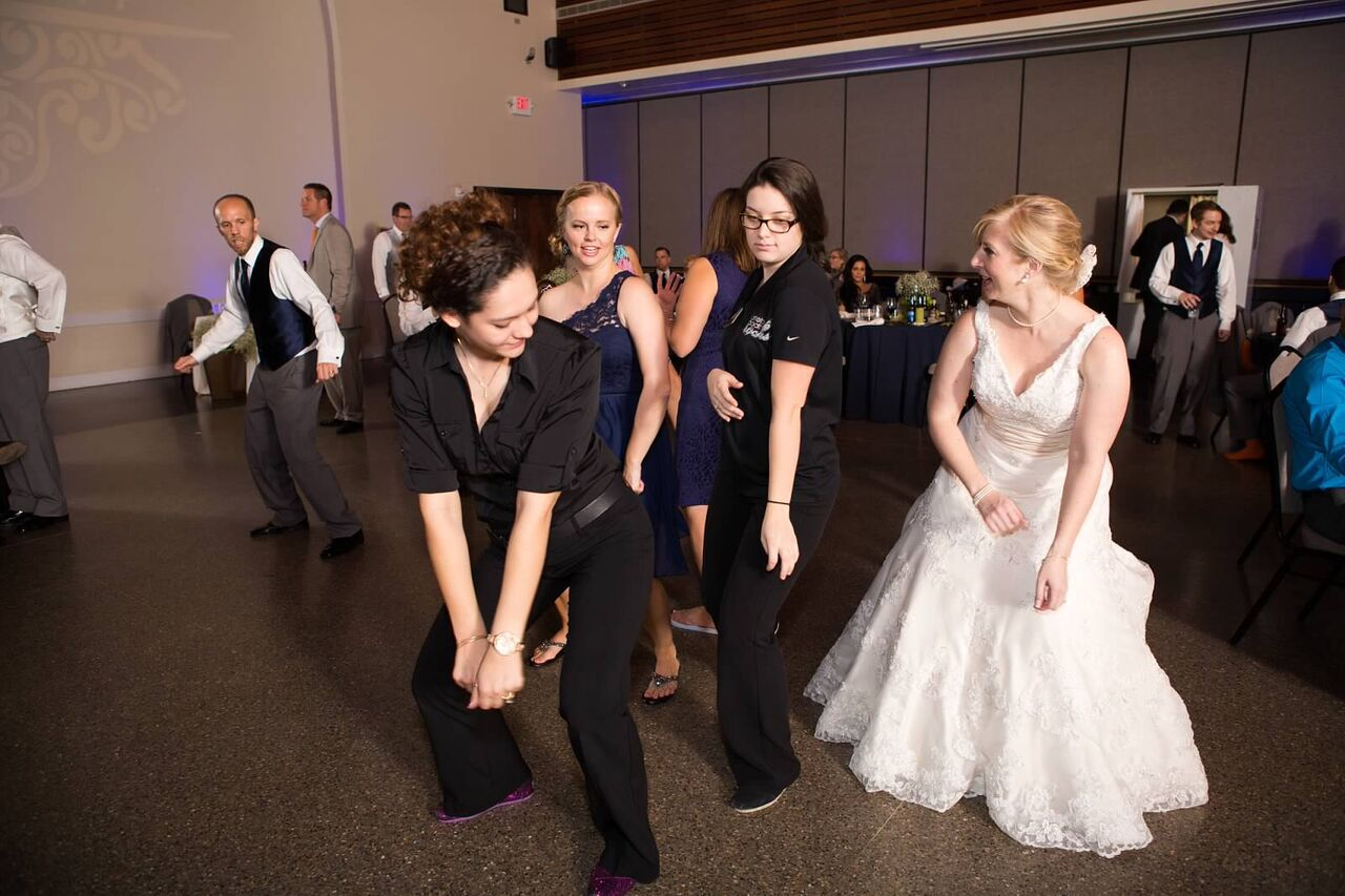 orlando wedding dj at winter park civic center wedding with amber and blue uplighting reception dancing