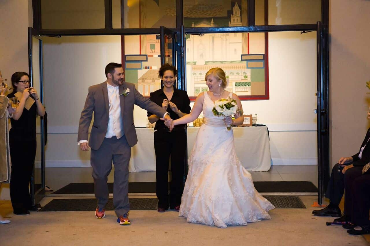 orlando wedding dj at winter park civic center wedding with amber and blue uplighting bride and groom entrance