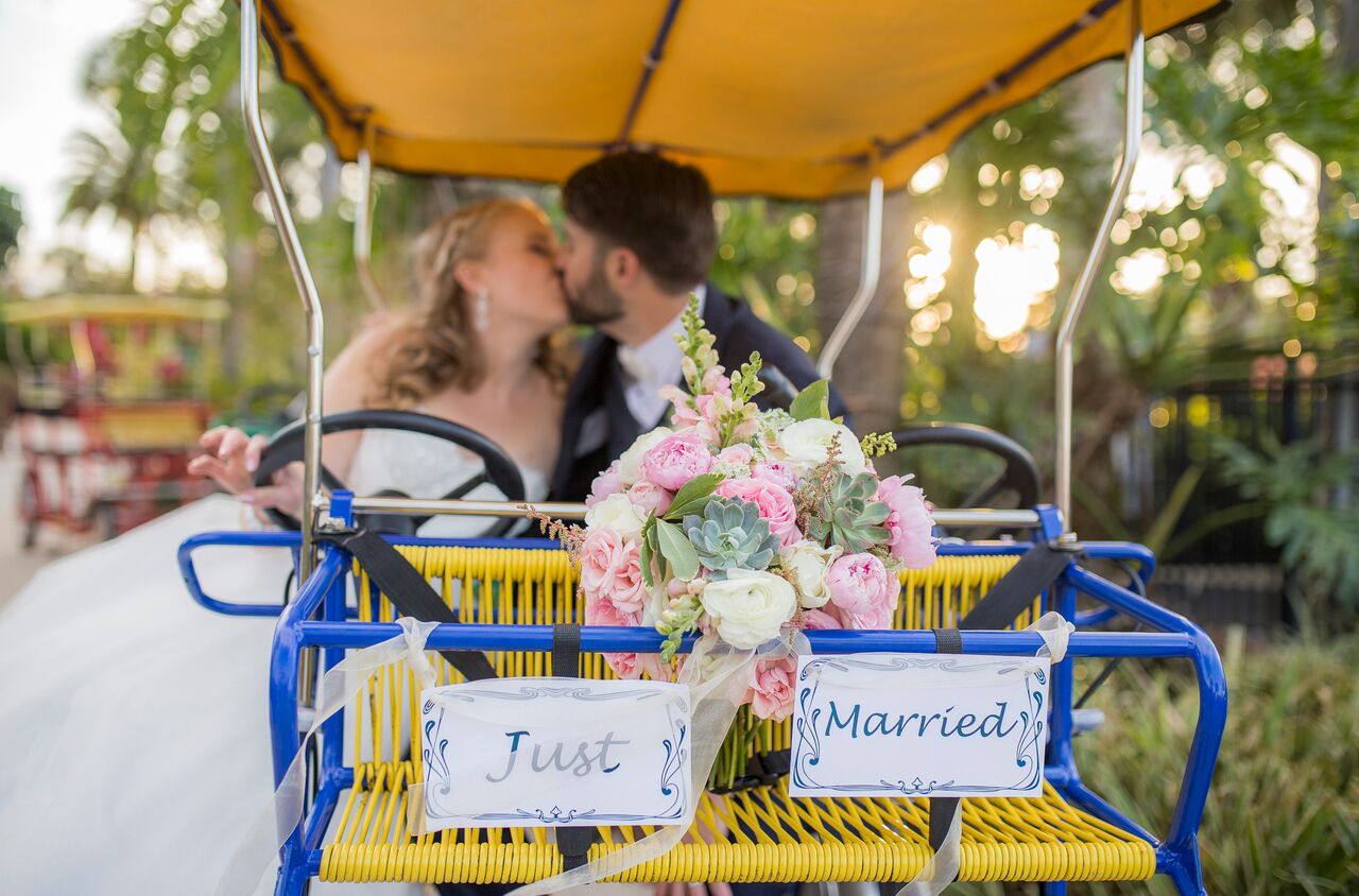 wedding dj experience at Hyatt Regency Grand Cypress wedding bride and groom kissing on bike