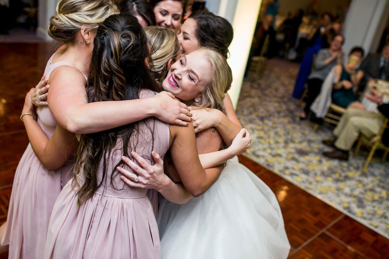 wedding dj experience at Hyatt Regency Grand Cypress wedding bride and bridesmaids group hug