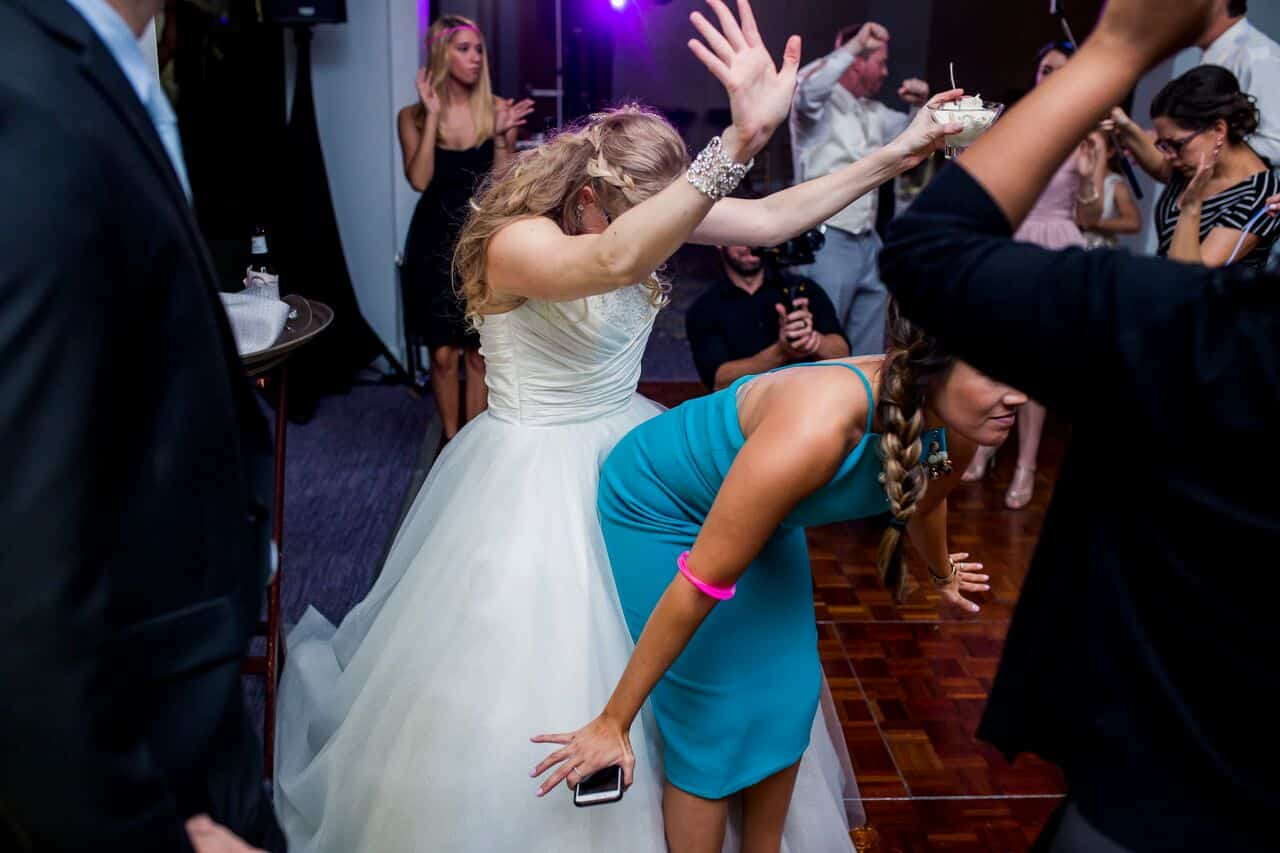 wedding dj experience at Hyatt Regency Grand Cypress wedding bride and guest dancing on dance floor at reception