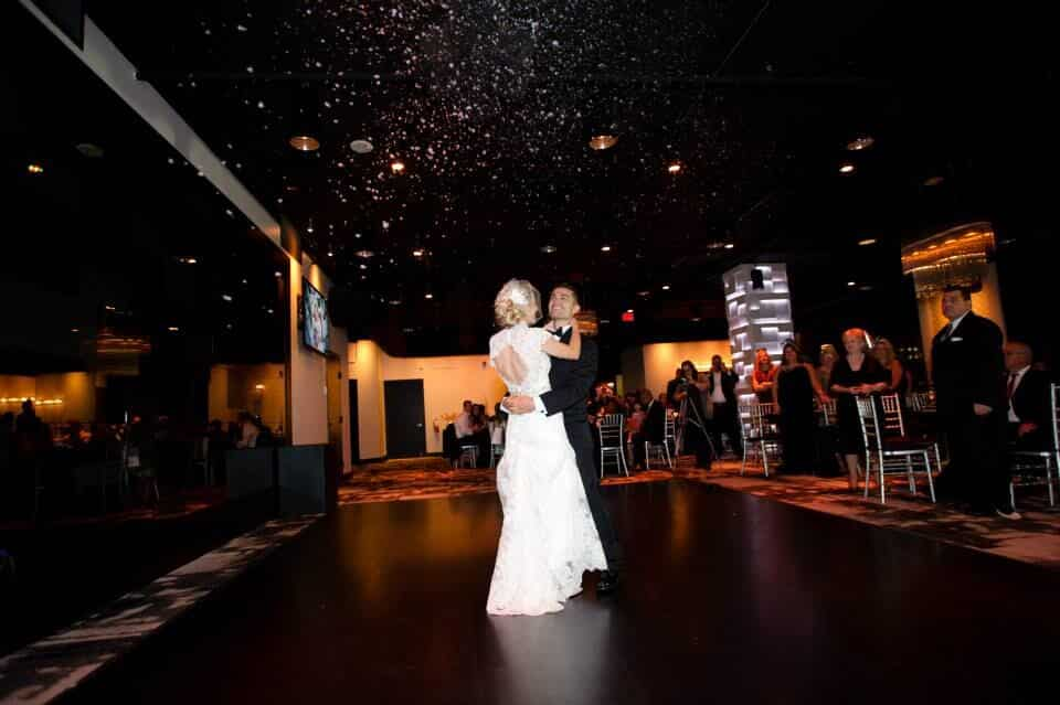 orlando wedding DJ at the Mezz NYE wedding bride and groom first dance with snow