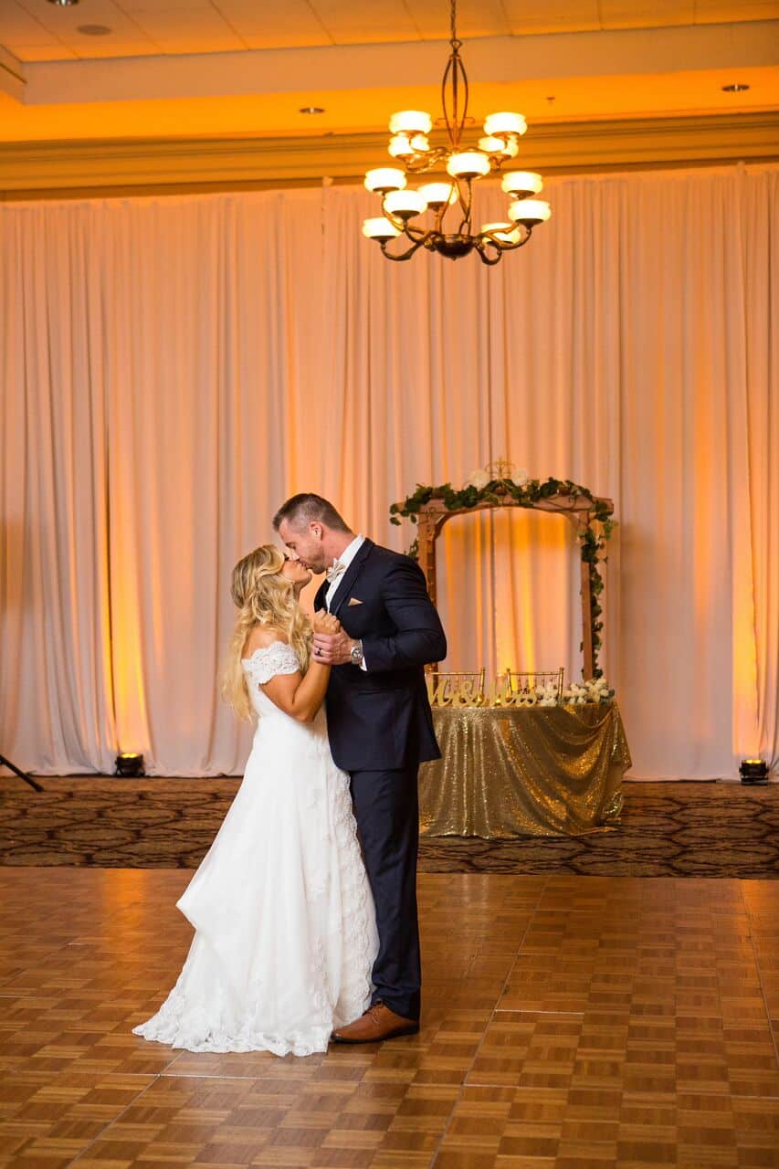 orlando wedding dj experience at holy trinity reception center bride and groom first dance with amber uplighting