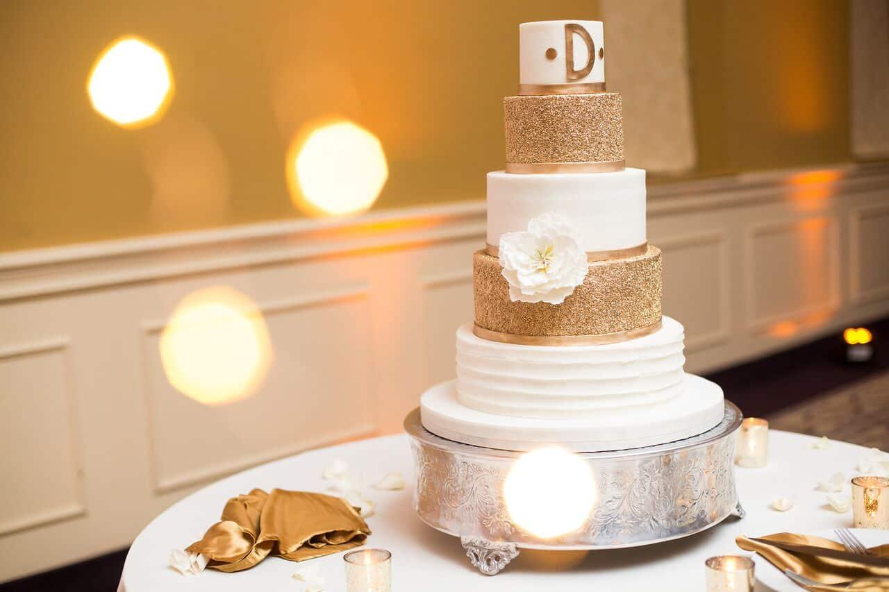orlando wedding dj experience at holy trinity reception center wedding cake with amber uplighting