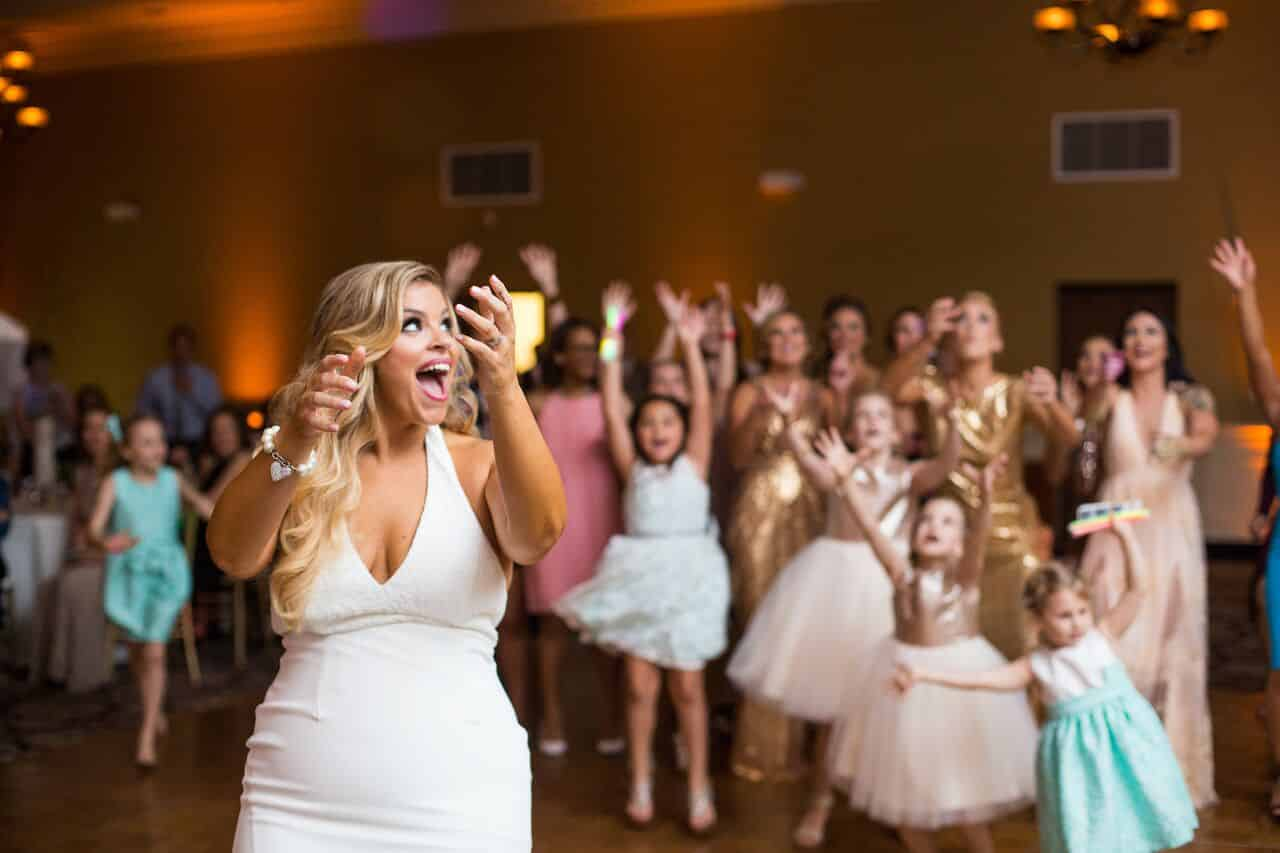 orlando wedding dj experience at holy trinity reception center bride bouquet toss with amber uplighting