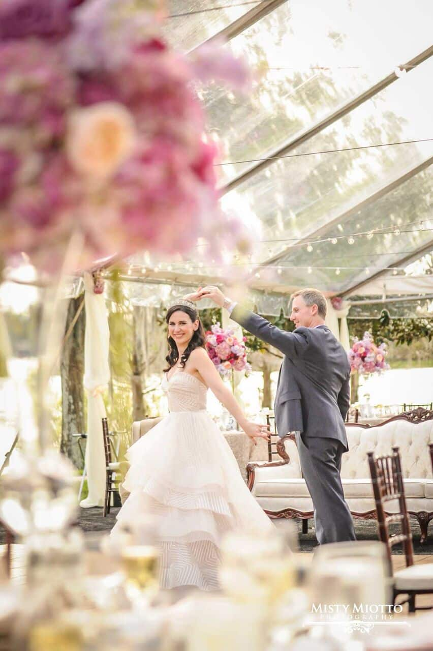 wedding dj fun at Cypress Grove Estate House wedding bride and groom dancing in clear tent