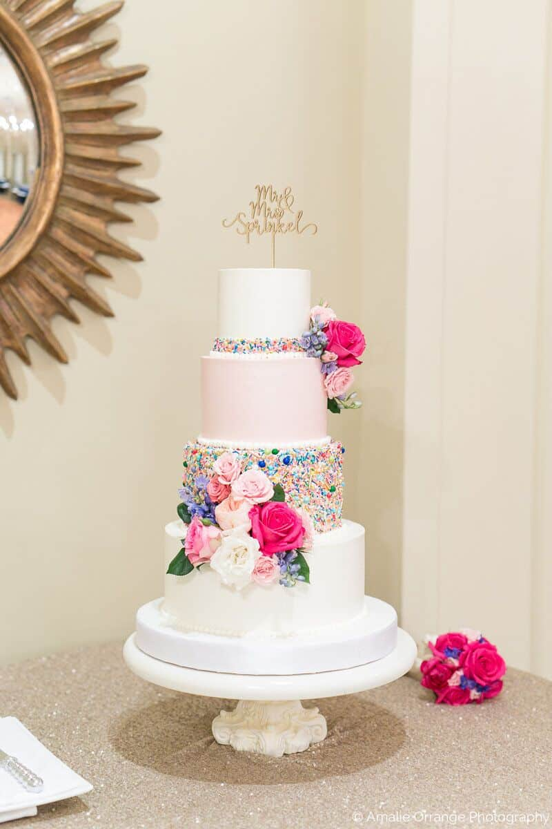 wedding cake with sprinkles at Interlachen Country Club with amber uplighting