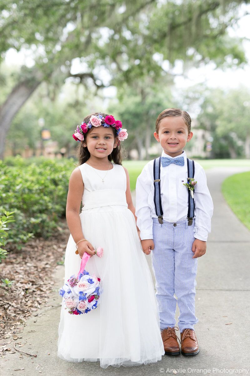 wedding flower girl and ring bearer at Interlachen Country Club with amber uplighting