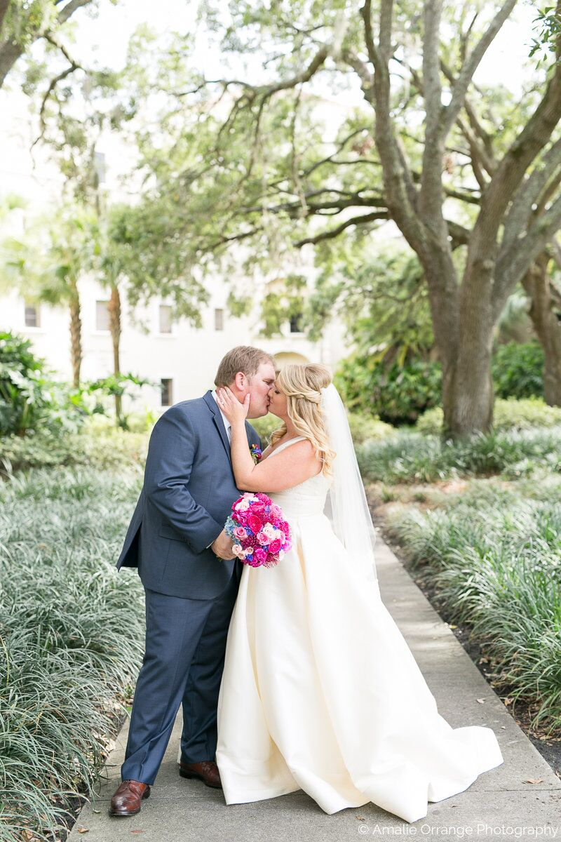 wedding at Interlachen Country Club with amber uplighting bride and groom kissing